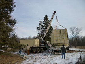 Container being lifted onto foundation