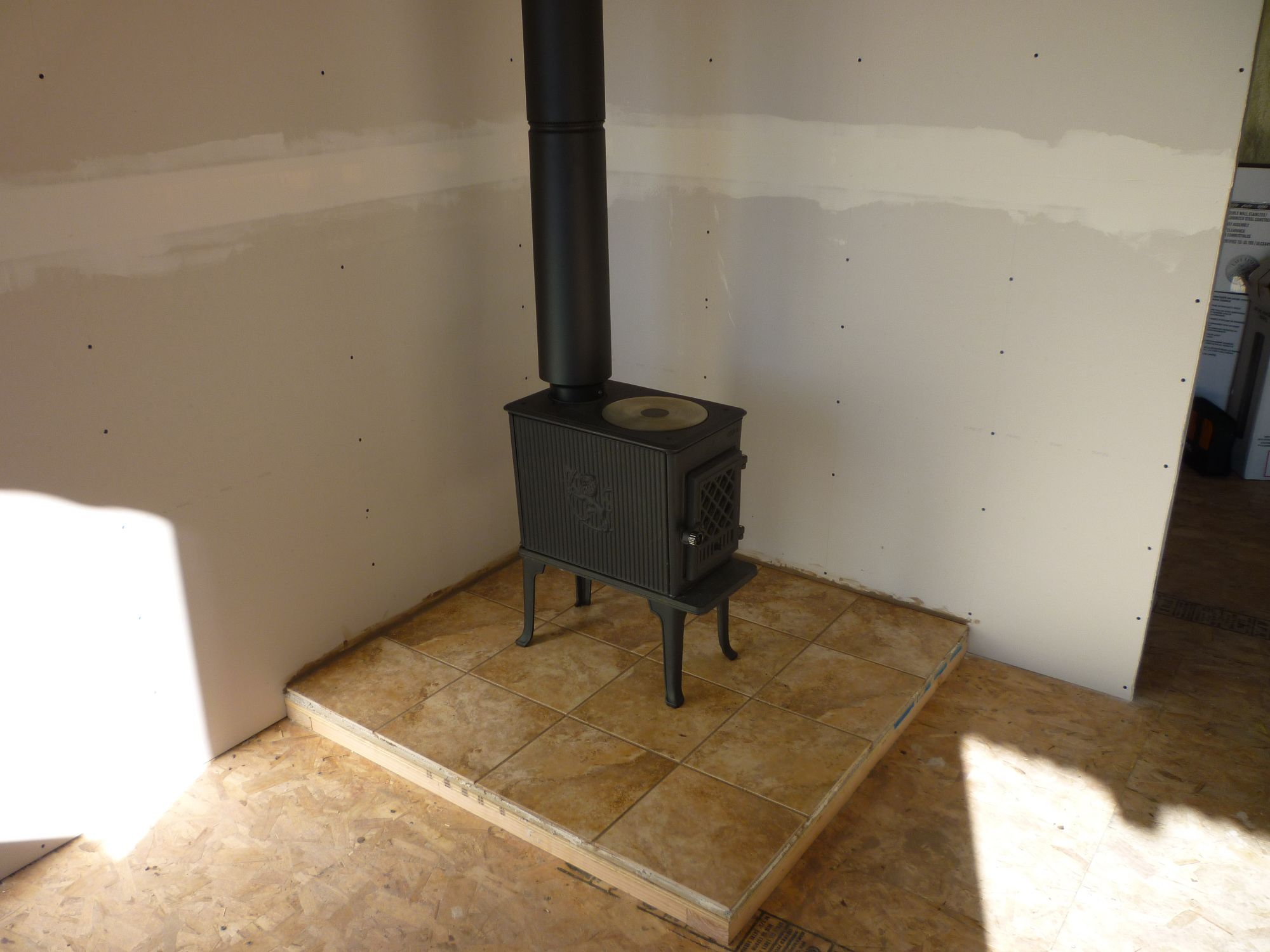 Wood Stove and Chimney - Tin Can Cabin